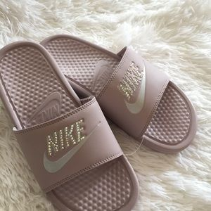 Pink Nike slides with studs